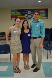 Anna, Avia, and Bobby pose for a photo during Mocktails.