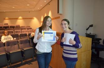 """Sarah receives the """"Brother of the Month"""" award for most September service hours."""
