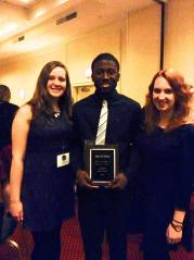 (Left to Right: Jennifer Balinski, Stefan Toussaint and Lauren Johnson) Accepting the Pledge Excellence award for ZU